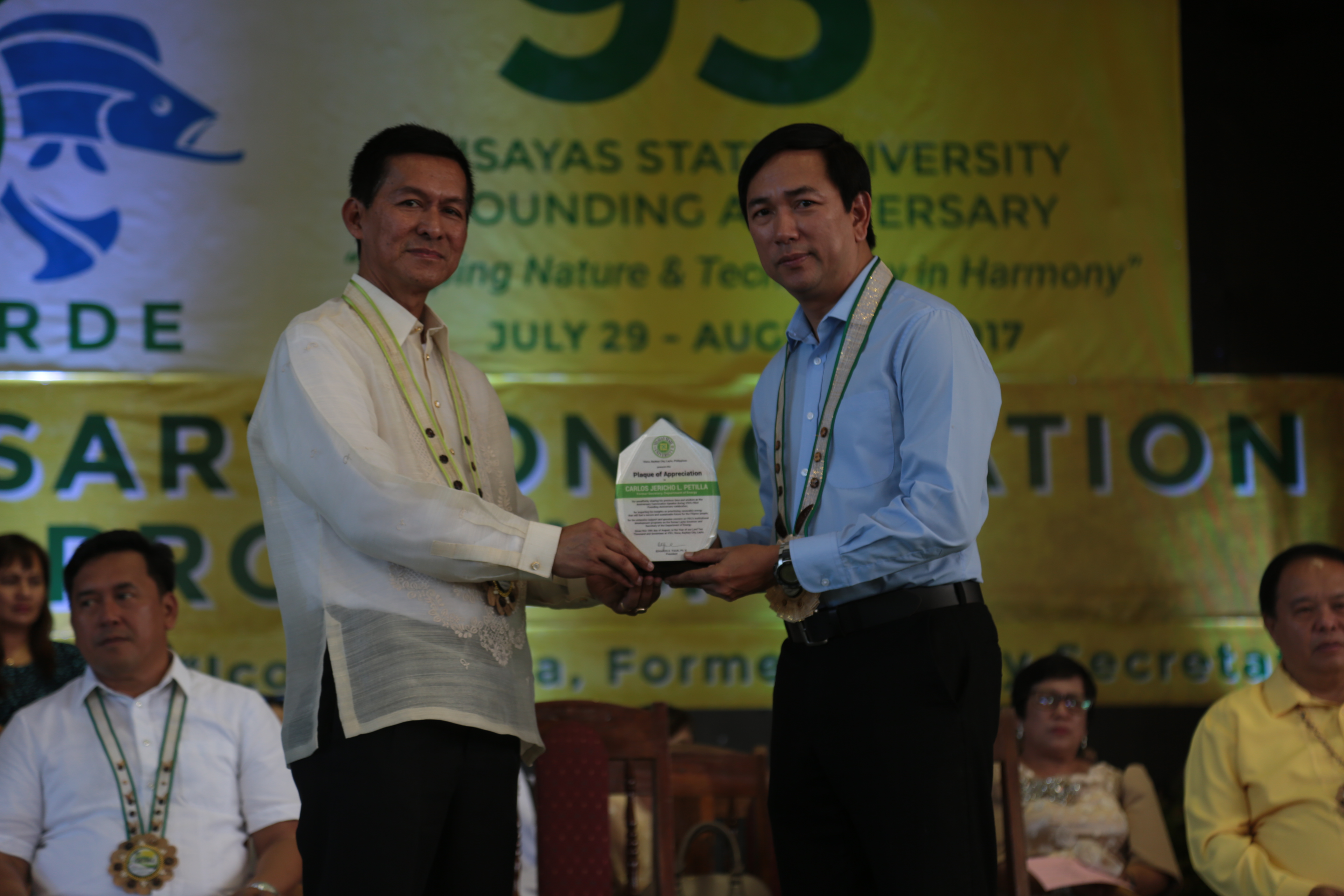 GLOBALIZATION. Former Department of Energy (DOE) Secretary and ex-Leyte Governor, Jericho 'Icot' Petilla, receiving the plaque of appreciation from University President Dr. Edgardo E. Tulin during the 93rd Anniversary Convocation. Photo by VSU Media Team