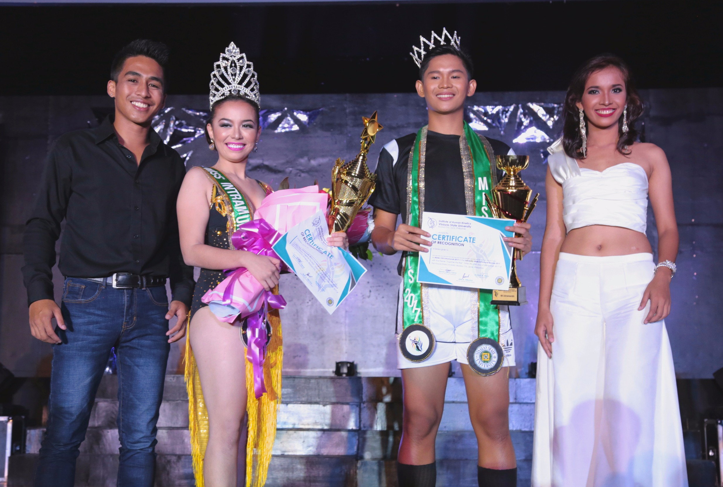 REFINED. Sylvan Dragon's, Mr. Nichol John Suficiencia and Guardian's, Ms. Trishia Jade Acilo posing with Mr. Alexander Luminario and Ms. Carmela Rustia after being crowned Mr. and Ms. Intramurals 2017. Photo by VSU Web Teams